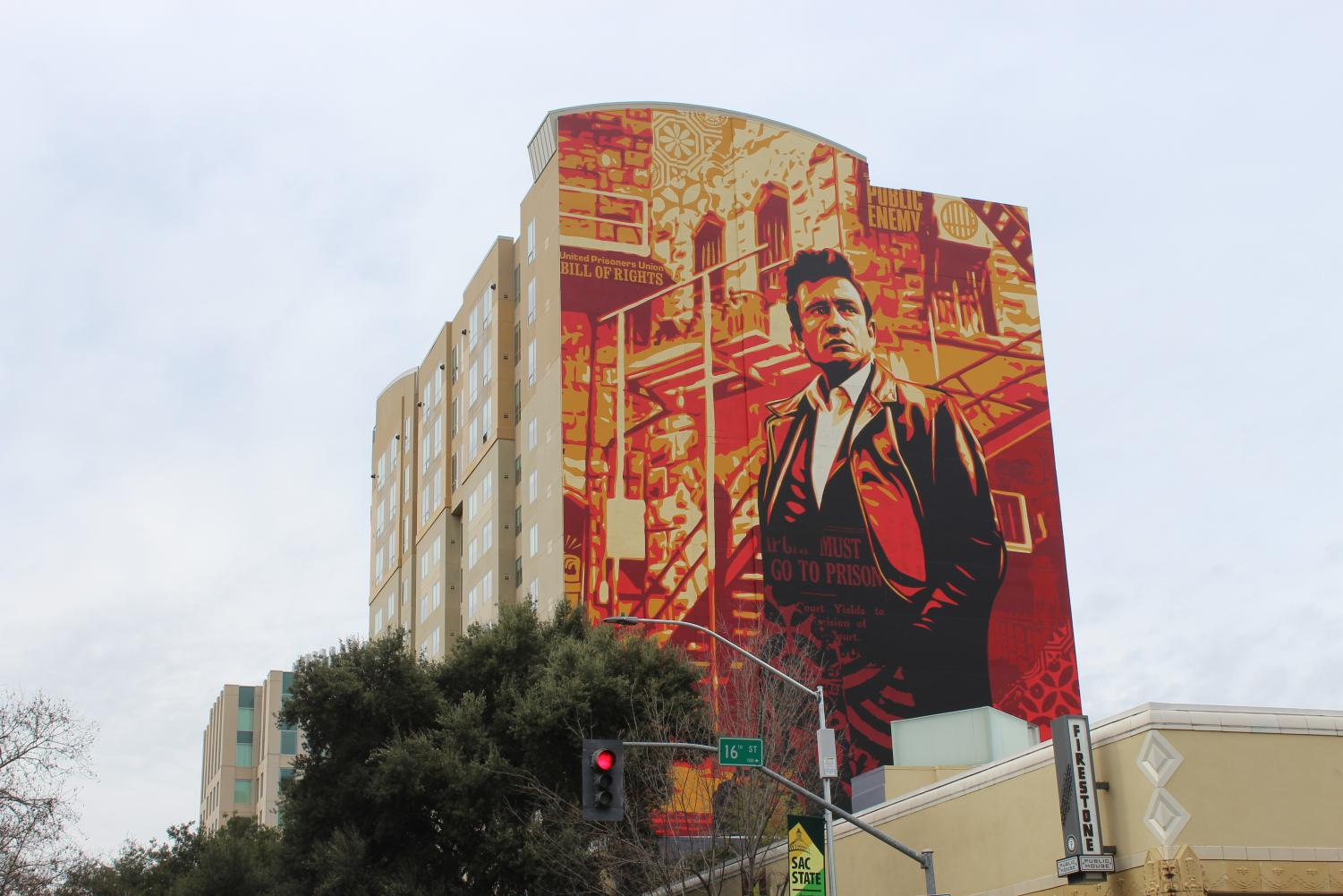 The Johnny Cash mural on L Street's Residence Inn by Marriott downtown was put up as part of the 2018 Wide Open Walls festival. Sac State students have differing opinions on whether there should be a mural dedicated to Stephon Clark.