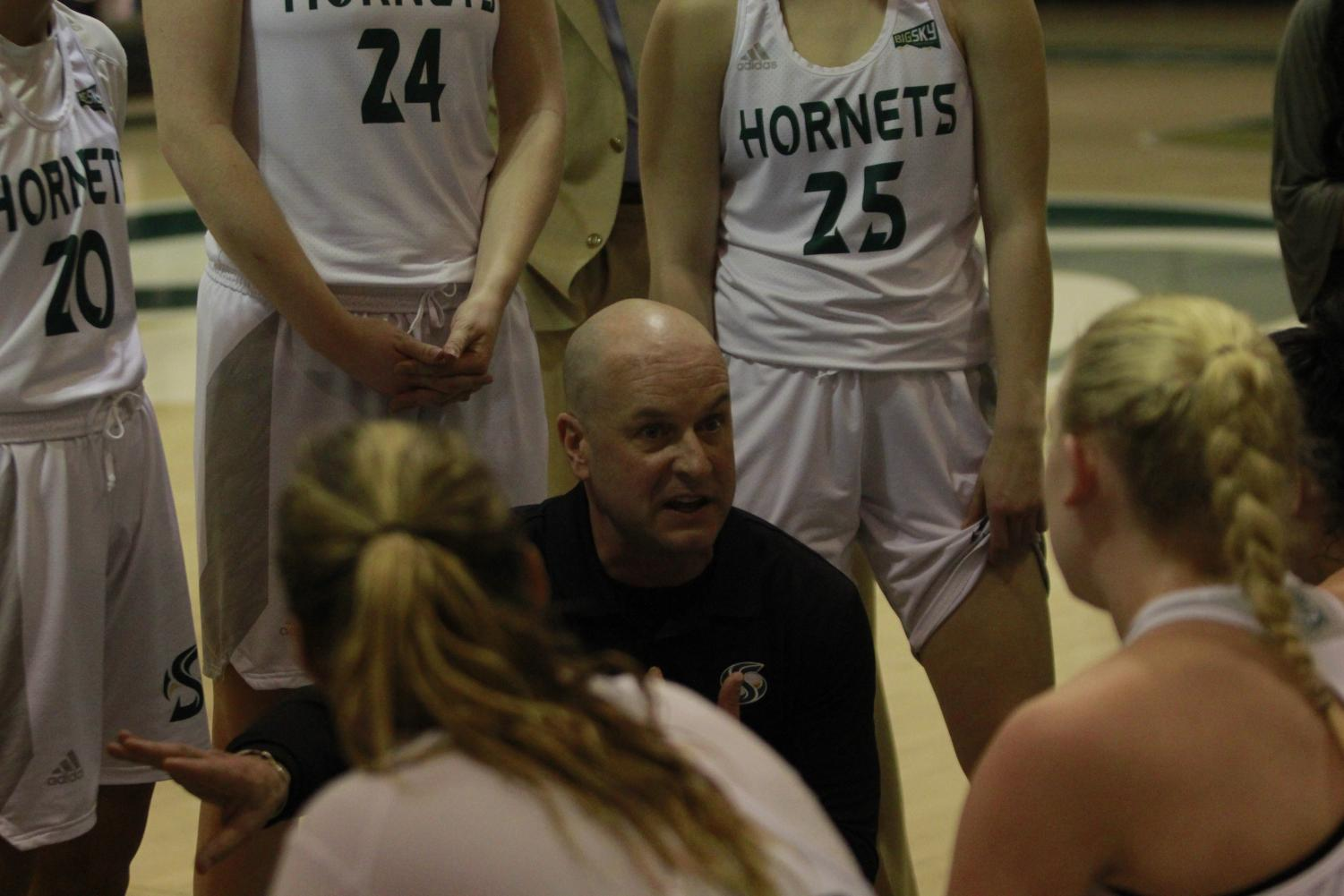 Sac State head coach Bunky Harkleroad talks to his team during a timeout huddle in a 69-65 loss to Idaho Saturday at the Nest. The Hornets have two regular seasons games left on the road before the Big Sky Conference tournament in Boise, Idaho begins March 11.