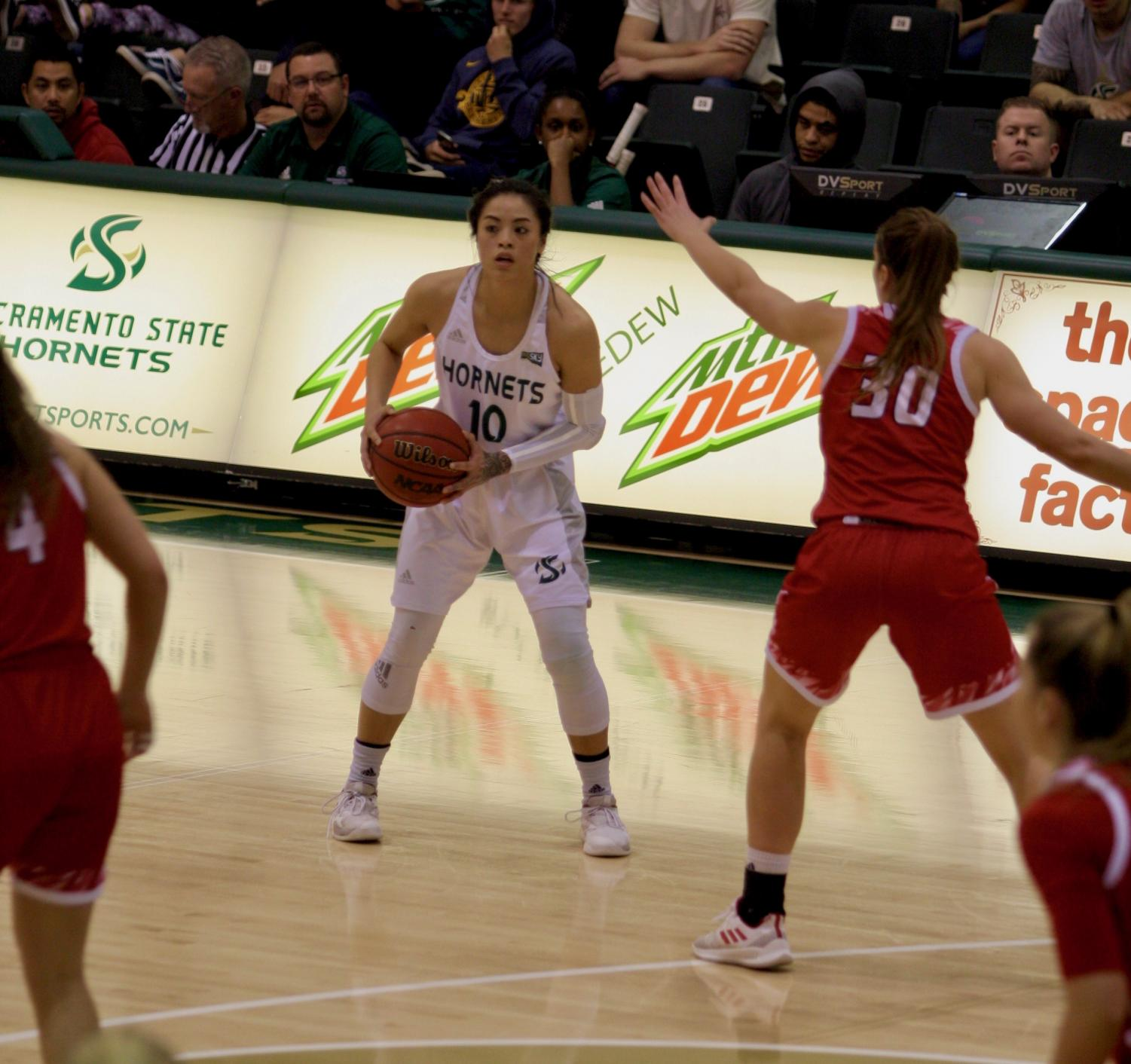 Sac State junior guard Gabi Bade prepares to pass in a 71-62 loss against Eastern Washington Feb. 28 at the Nest. Bade had a game-high 23 points on 6 of 10 from three.