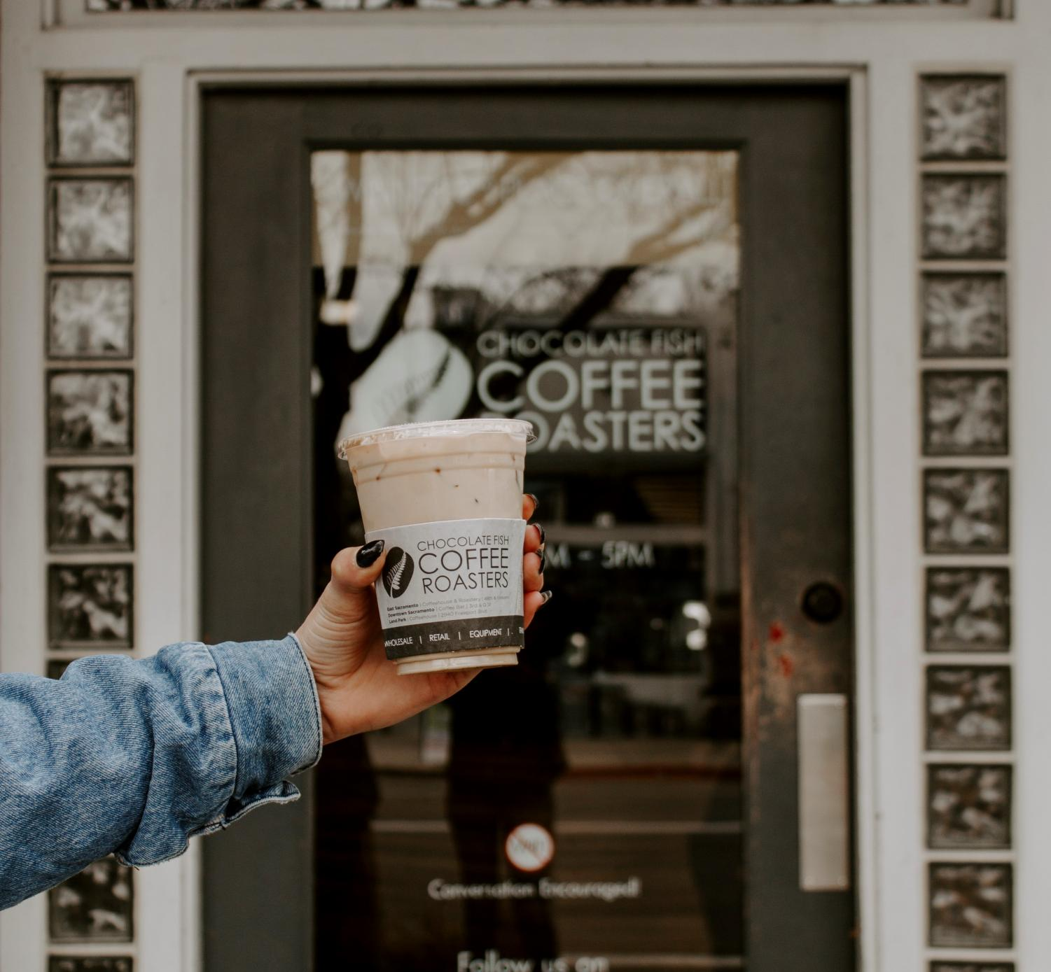 An iced vanilla latte in front of Chocolate Fish Coffee Roasters on Feb. 24. Order an iced latte for a quick caffeine fix to get you through the day.