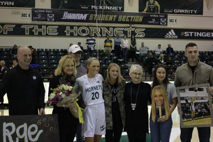 Sac+State+senior+guard+Raegen+Rohn+%28center%29+poses+with+head+coach+Bunky+Harkleroad+%28far+left%29+and+her+family+on+senior+day+Saturday+at+the+Nest.