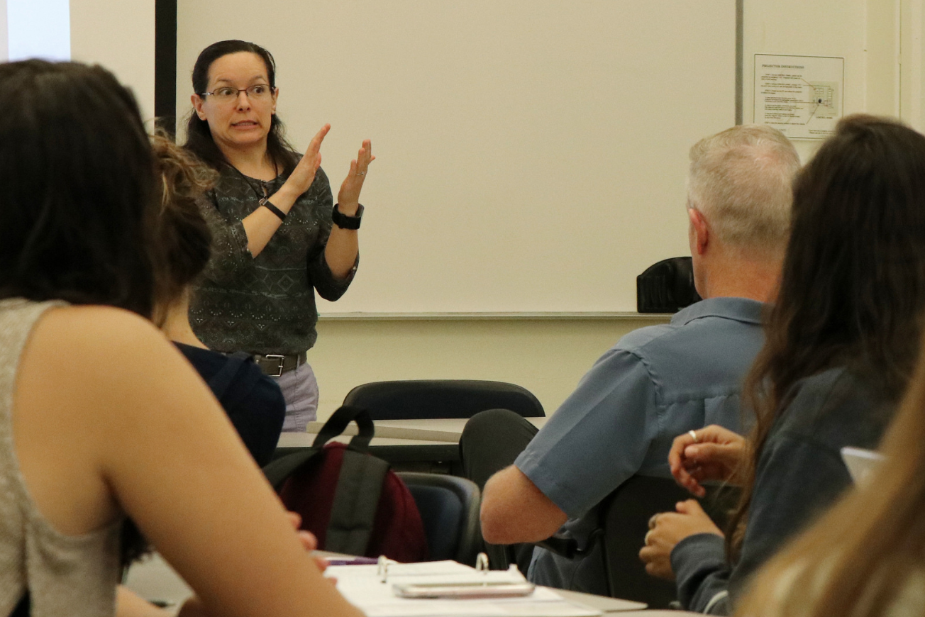Leah Zarchy, assistant professor and American Sign Language and deaf studies program coordinator, gives an ASL presentation at CelebratEd at Sac State on Sept. 17, 2018.
