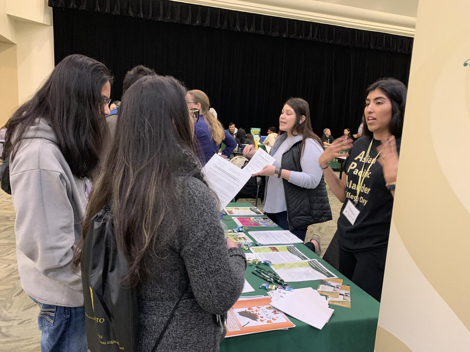 Students talk to college organizations in the University Union ballroom on Friday, March 29 during Asian Pacific Islander College day. Students were able to talk to different organizations and departments about what university resources are offered.