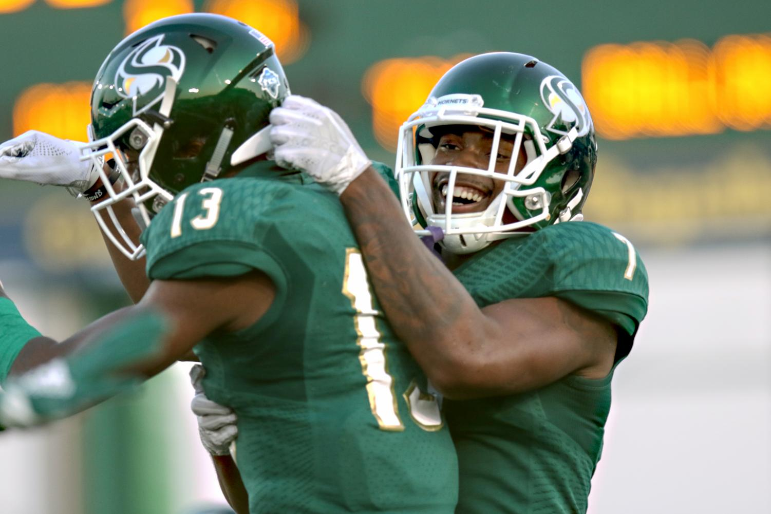 Sacramento State wide receiver Andre Lindsey (7) celebrates with Jaelin Ratliff during the 2018 season. Lindsey signed with the Kansas City Chiefs as an undrafted free agent following the 2019 NFL Draft.