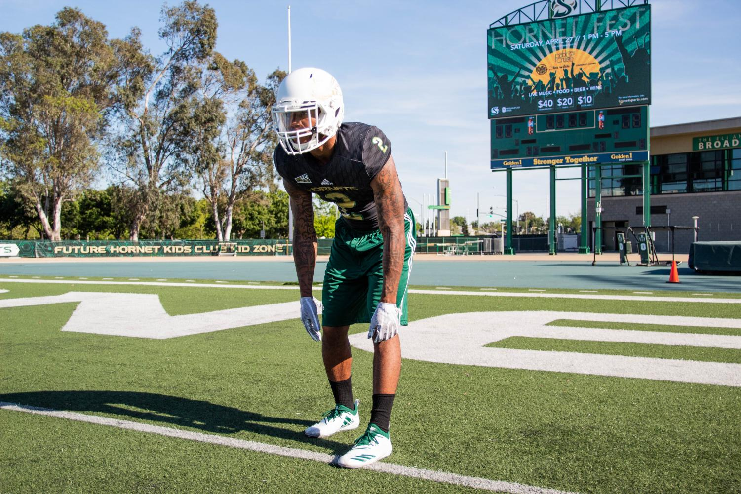 Sac+State+senior+safety+Mister+Harriel+lines+up+as+he+does+during+a+game+April+18+at+Hornet+Stadium.+Harriel+is+hopeful+to+be+selected+in+the+2019+NFL+Draft.