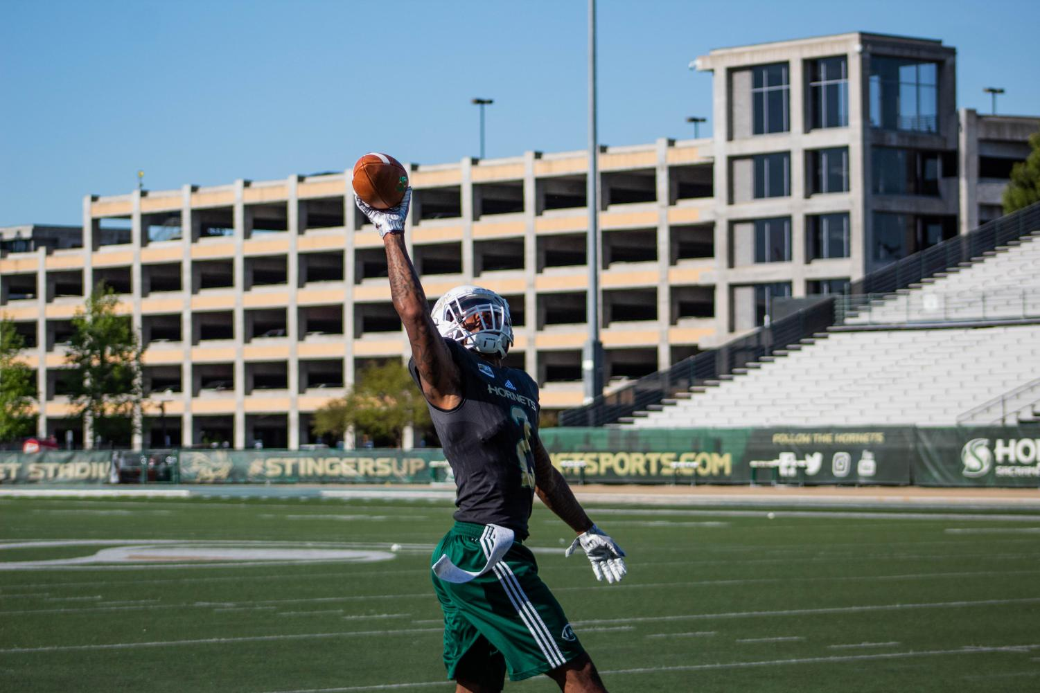 Sac+State+senior+safety+Mister+Harriel+catches+a+pass+with+one-hand+April+18+at+Hornet+Stadium.+Harriel+is+hopeful+to+be+selected+in+the+2019+NFL+Draft.