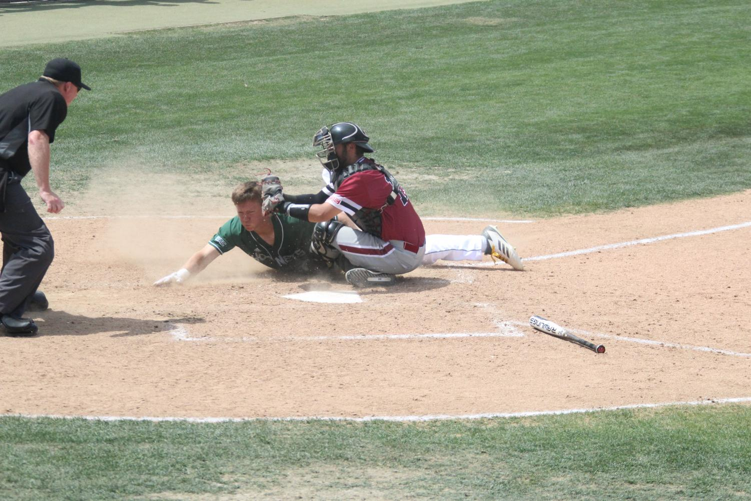 Sacramento State junior outfielder Matt Smith dives head first in an attempt to score, but is called out  in a 3-2 loss against New Mexico State at John Smith Field April 28, 2019. The Hornets lost their first WAC series of the 2019 season.