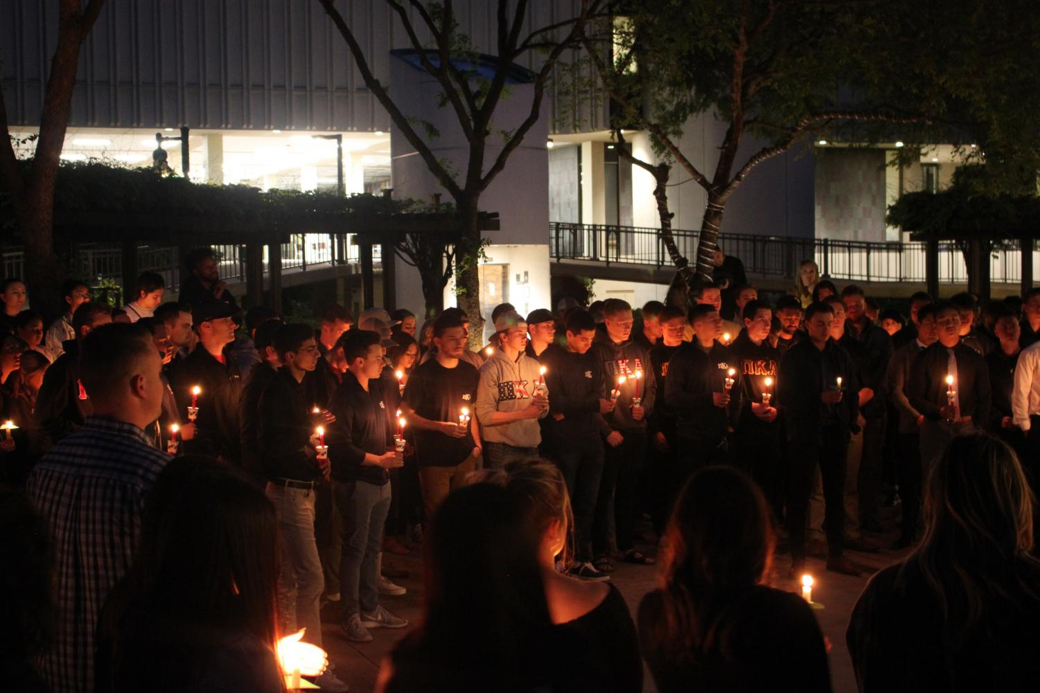 Brothers of the Pi Kappa Alpha fraternity at Sac State hold a vigil for William Molina, the 21-year-old student who died in a pellet gun shooting on Friday morning. Among the vigil's attendees were other Sac State Greek members and President Robert Nelsen.