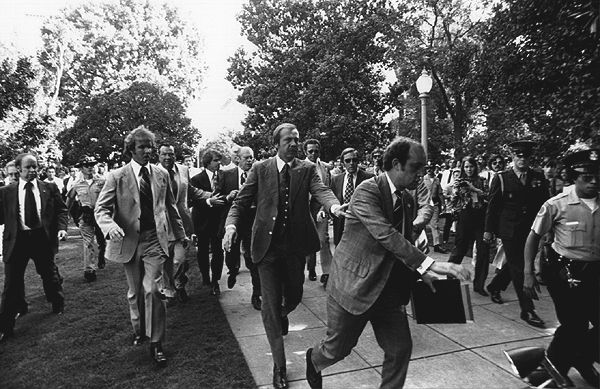 """Following the September 5, 1975 attempt on U.S. President Gerald Ford's life by cultist Charles Manson Family member Lynette """"Squeaky"""" Fromme, Secret Service agents rush President Ford towards the California State Capitol in Sacramento."""