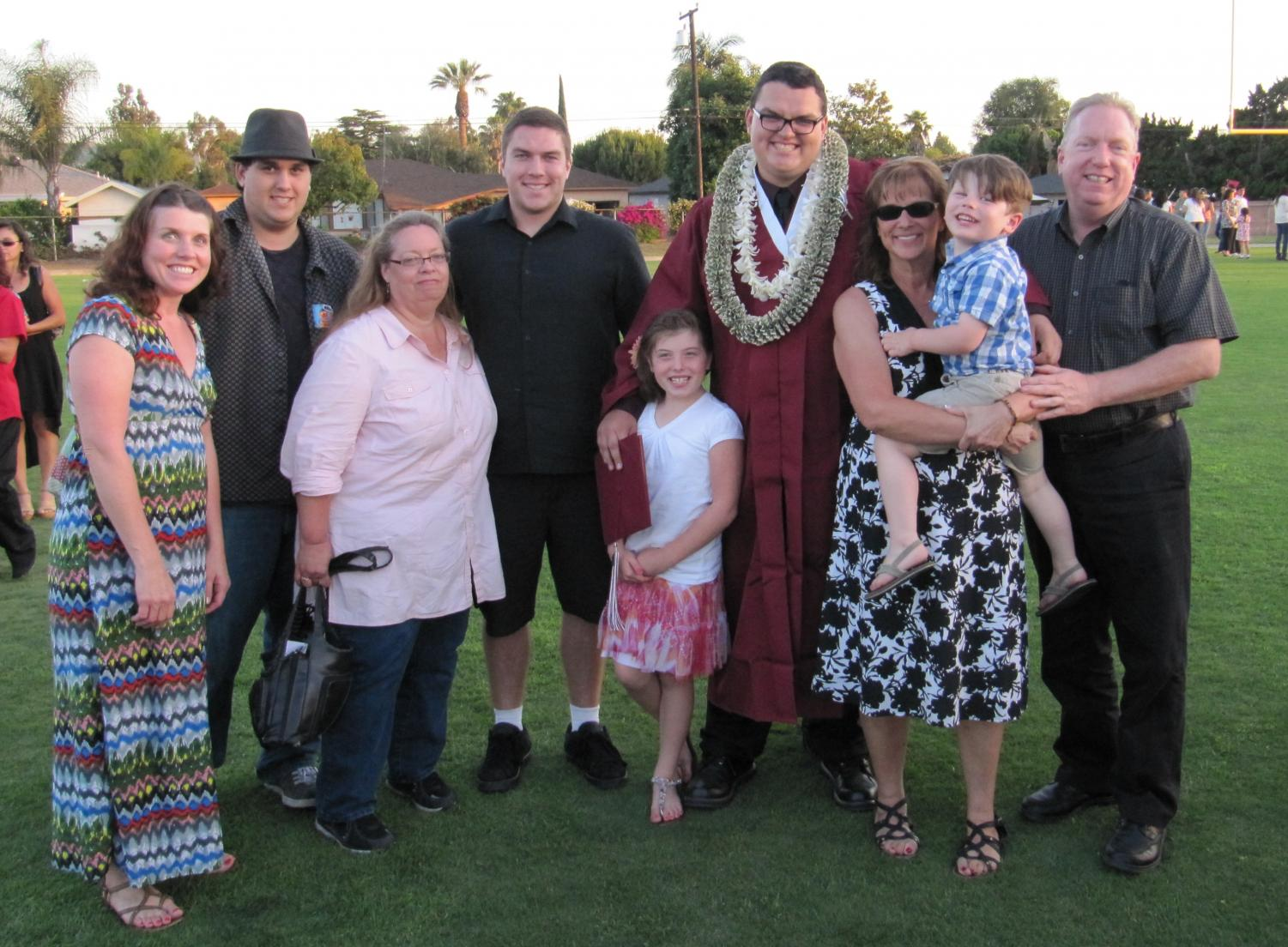 My+family+with+my+aunt+Cheri%2C+far+left%2C+aunt+Sandy%2C+third+from+left%2C+and+maternal+cousins+at+my+high+school+graduation.+My+aunts+and+cousins+were+some+of+the+only+few+people+invited+to+my+mom%27s+private+funeral.%0A