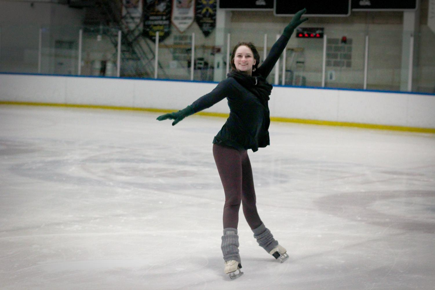 Sac State graduate student Samantha Mapes skates at Skatetown Ice Arena in Roseville. Mapes, who was in Disney on Ice for three years, shows off one of her favorite moves.