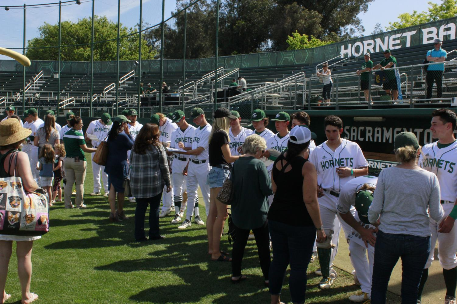 Members+of+the+Sac+State+baseball+team+sign+autographs+for+fans+following+a+5-4+win+Sunday+over+CSU+Bakersfield+at+John+Smith+Field.+The+Hornets+now+go+on+a+nine+game+road+trip+beginning+Tuesday+at+Santa+Clara.