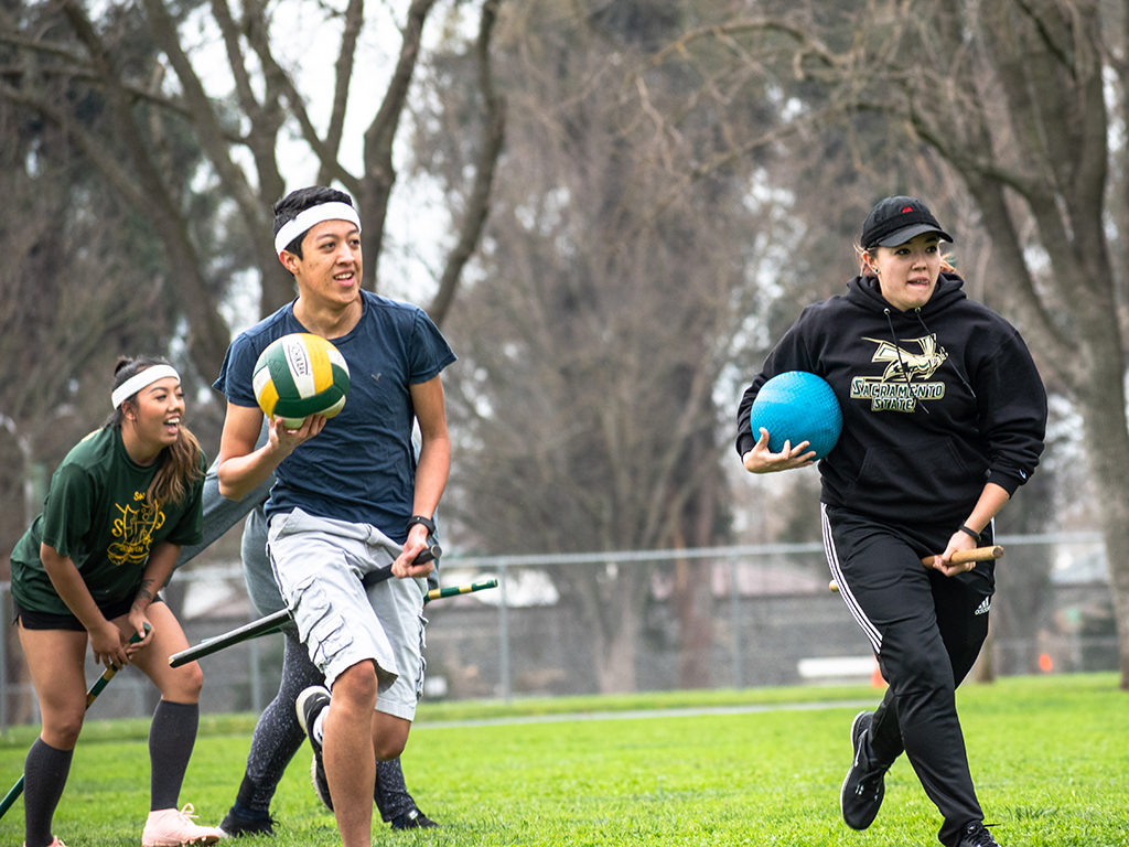 Francisco Tarin and Michaela Dunnam maintain possession of a quaffle and bludger during a Sac State Quidditch Team practice match on Feb 1, 2019.