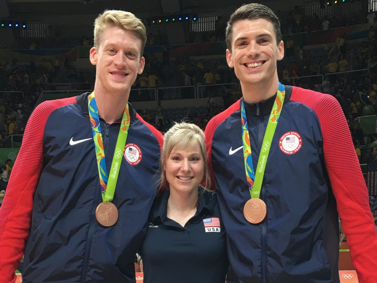 Andrea Becker poses for a photo between US National volleyball players Max Holt and Matt Anderson. The team won bronze at the 2016 Olympics.