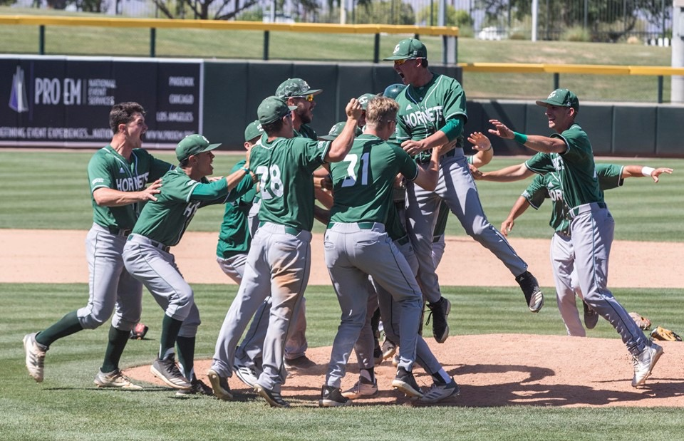 The Sac State baseball team celebrates winning the WAC tournament against Grand Canyon University on Sunday, May 26 at Hohokam Stadium in Mesa, Ariz. The Hornets defeated the Antelopes 5-4.