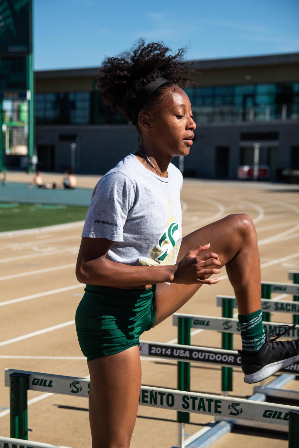 Track+athlete+Khala+Clarke+does+hurdle+drills+on+the+track.+Clarke+is+a+400-hurdler+with+an+outdoor+best+of+1%3A05.