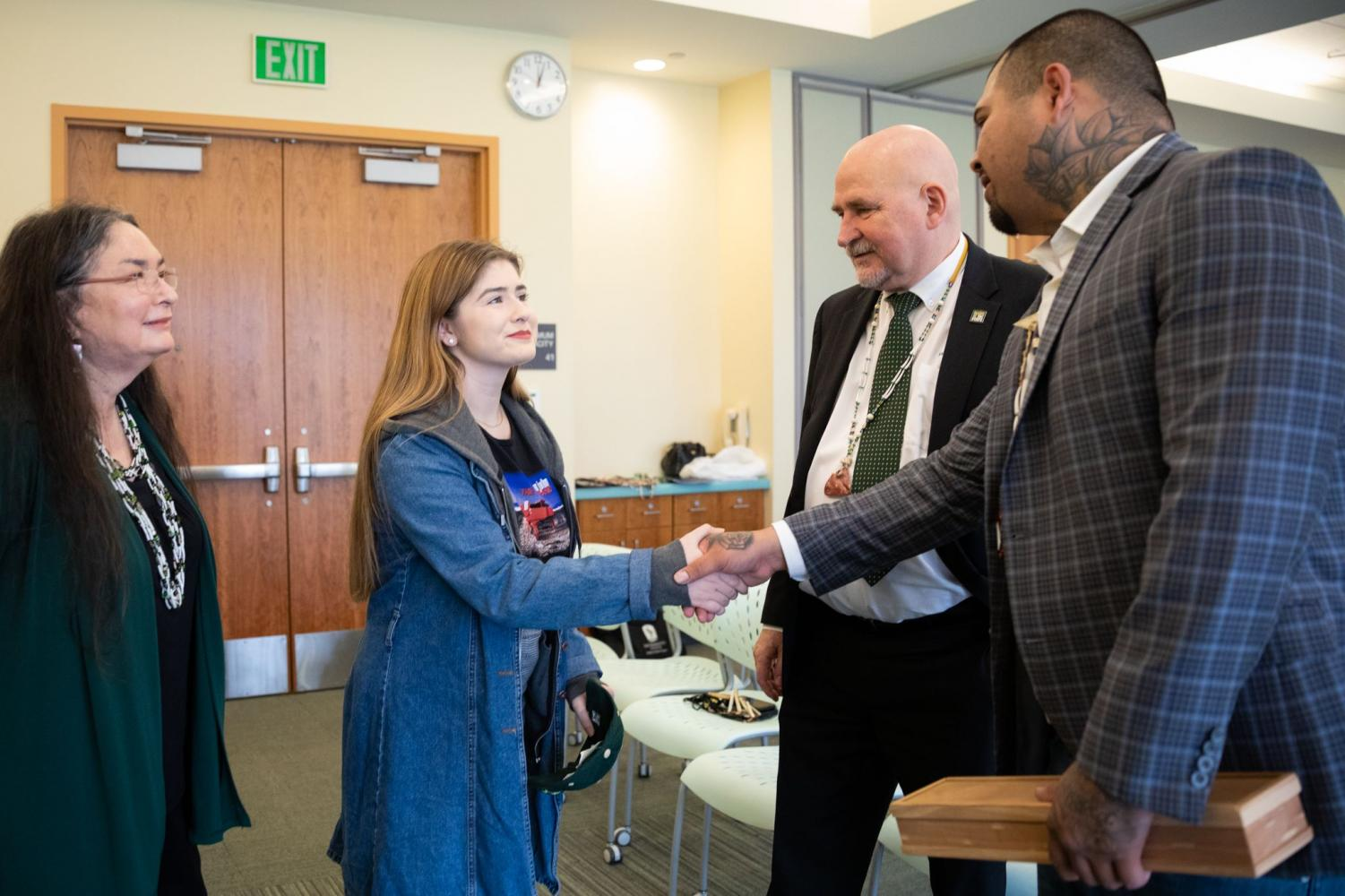 Sac State scholarship recipient Jordan Hernandez, shakes hands with Tribal Treasurer Matthew Lowell Jr. on March 6. On that day, the Yocha Dehe Wintun Nation announced their $750,000 donation to the Native American program at Sac State.