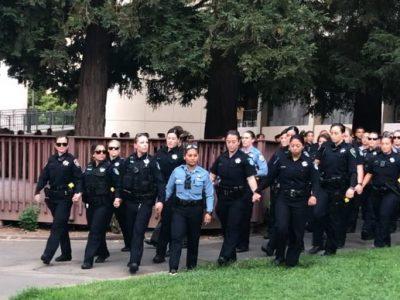 Hundreds gather at Sac State vigil honoring slain police