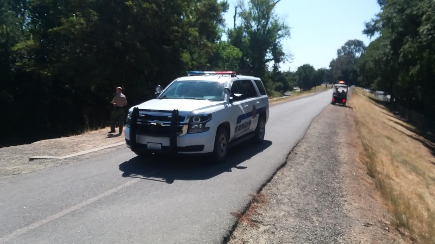 Sacramento County Park Rangers assist the Sacramento State Police Department and Sacramento police apprehend a suspect who fled into the American River on Tuesday, August 20. The suspect fled downstream onto an island north of the J-Street Bridge where he surrendered to police.