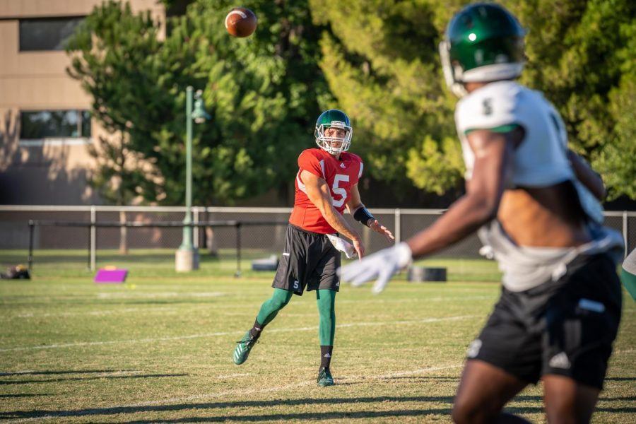 Sac+State+junior+quarterback+Kevin+Thomson+throws+a+pass+during+training+camp+on+Tuesday%2C+August+12+at+the+practice+field.+Thomson+averaged+9.52+yards+per+completion+in+2018%2C+ranking+second+in+program+history+only+trailing+the+record+he+set+in+2017.+