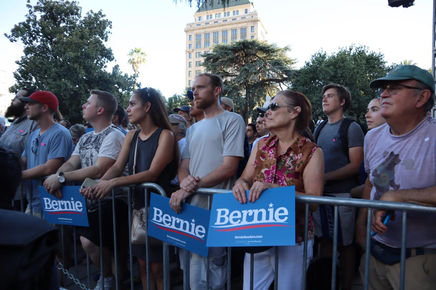 Onlookers+listen+to+the+speakers+at+Bernie%27s+Sanders+Cesar+Chavez+Plaza+campaign+rally+on+Thursday%2C+Aug.+22%2C+2019.+Topics+ranged+from+unionization%2C+criminal+justice+reform%2C+climate+change+and+student+loans.