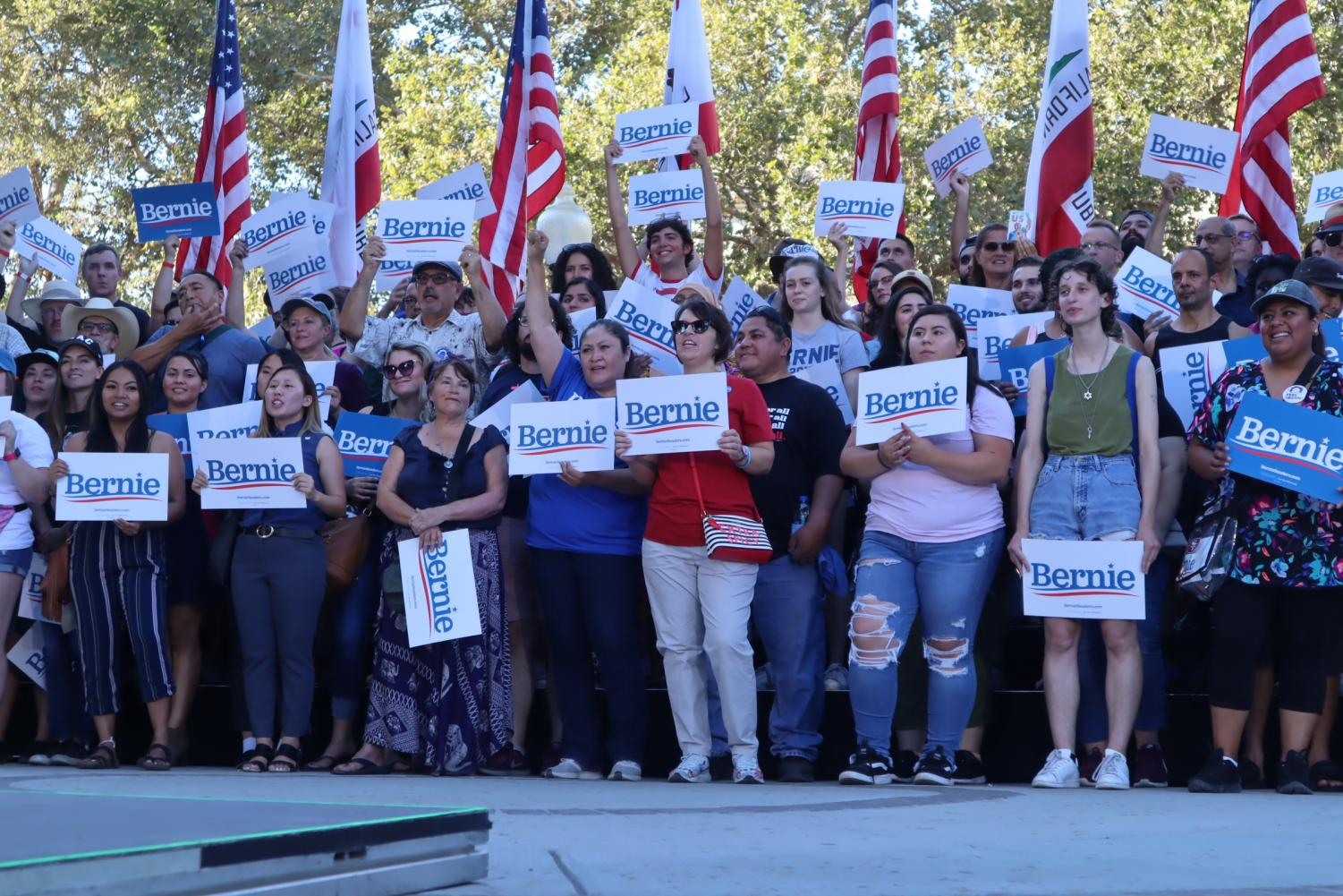 Supporters+stand+on+stage+at+Bernie+Sander%27s+campaign+rally+at+Cesar+Chavez+Plaza+on+Thursday%2C+Aug.+22%2C+2019.+Sanders+speech+would+focus+on+his+platform+of+climate+change%2C+student+loans%2C+Medicare+for+All+and+economic+equality.