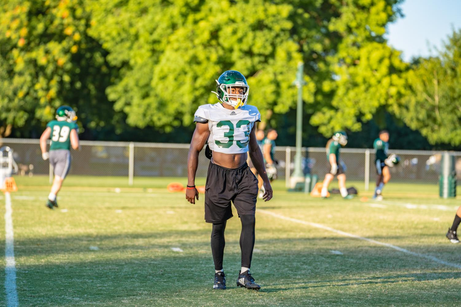 Sac+State+junior+running+back+Elijah+Dotson+walks+toward+the+sideline+during+training+camp+on+Tuesday%2C+August+12+at+the+practice+field.+Dotson+earned+first+team+All-Big+Sky+honors+in+2018%2C+becoming+the+first+Sac+State+RB+to+do+so+since+2000.