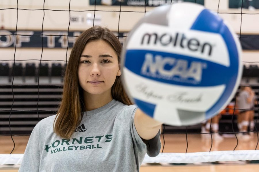 Senior outside hitter Sarah Davis poses for a photo before practice on Monday, Sept. 23 at The Nest. Davis has been named to the all-tournament team three separate times this season.