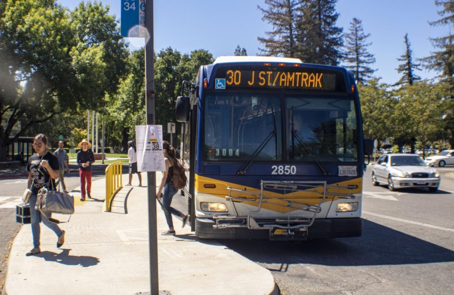 Riders get off and onto bus route 30 at Sac State on Tuesday, Sept. 3. Sacramento Regional Transit District bus routes are changing for passengers in the upcoming week and end of the year.