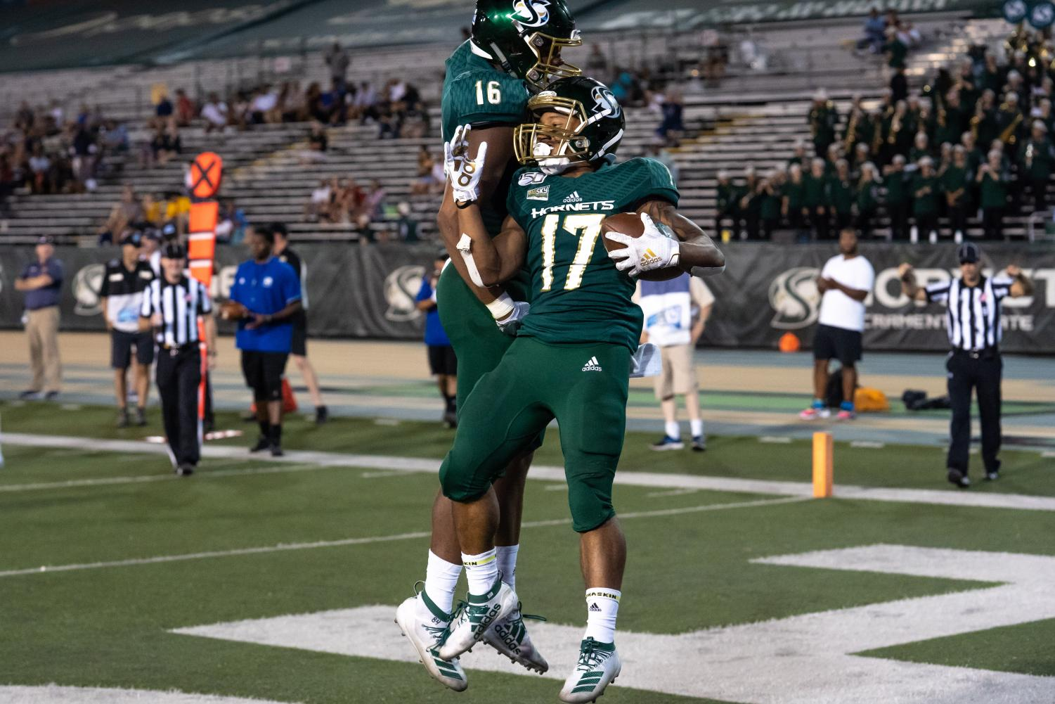 Sac State senior wide receiver Dewey Cotton, right, and freshman tight end Marshel Martin, left, celebrate after Cotton scored a touchdown against Northern Colorado on Saturday, Sept. 14, at Hornet Stadium. Cotton had a total of 14 yards receiving and one touchdown against the Bears.