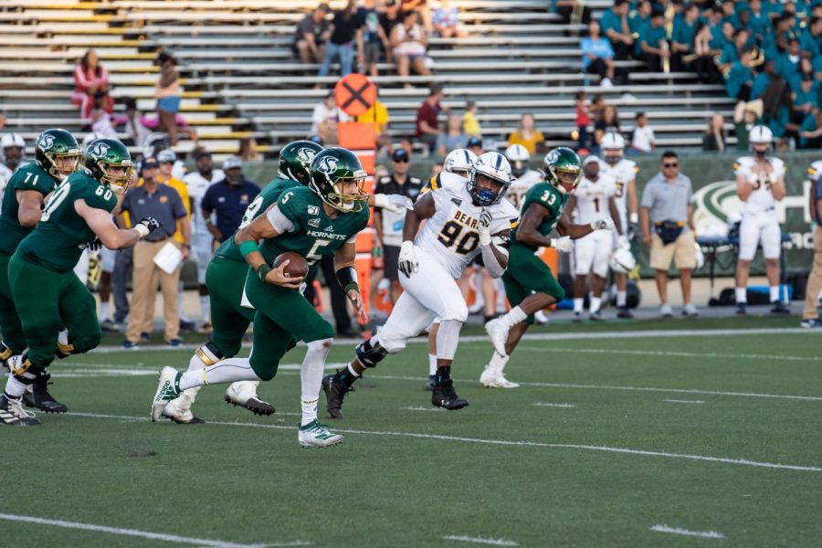 Sac State junior quarterback Kevin Thomson rushes for a first down against Northern Colorado on Saturday, Sept. 14, at Hornet Stadium. The Hornets play on the road this Saturday at Fresno State.