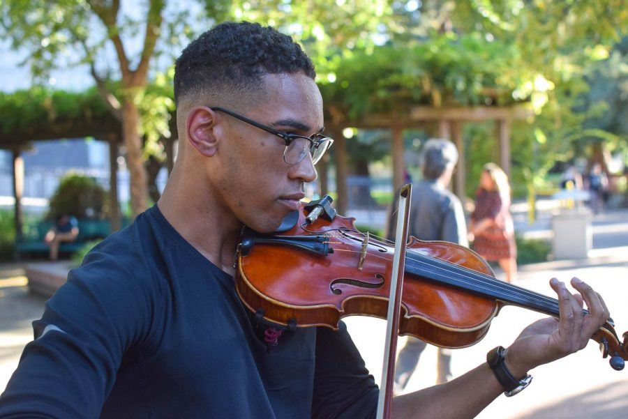 Matthew Major plays the violin in the Library Quad at Sacramento State on Sept. 23, 2019. The Matthew Major Inception Quintet, a jazz group comprised of Sac State music students, will be performing at UNIQUE Programs' Wednesday Nooner in the Serna Plaza.