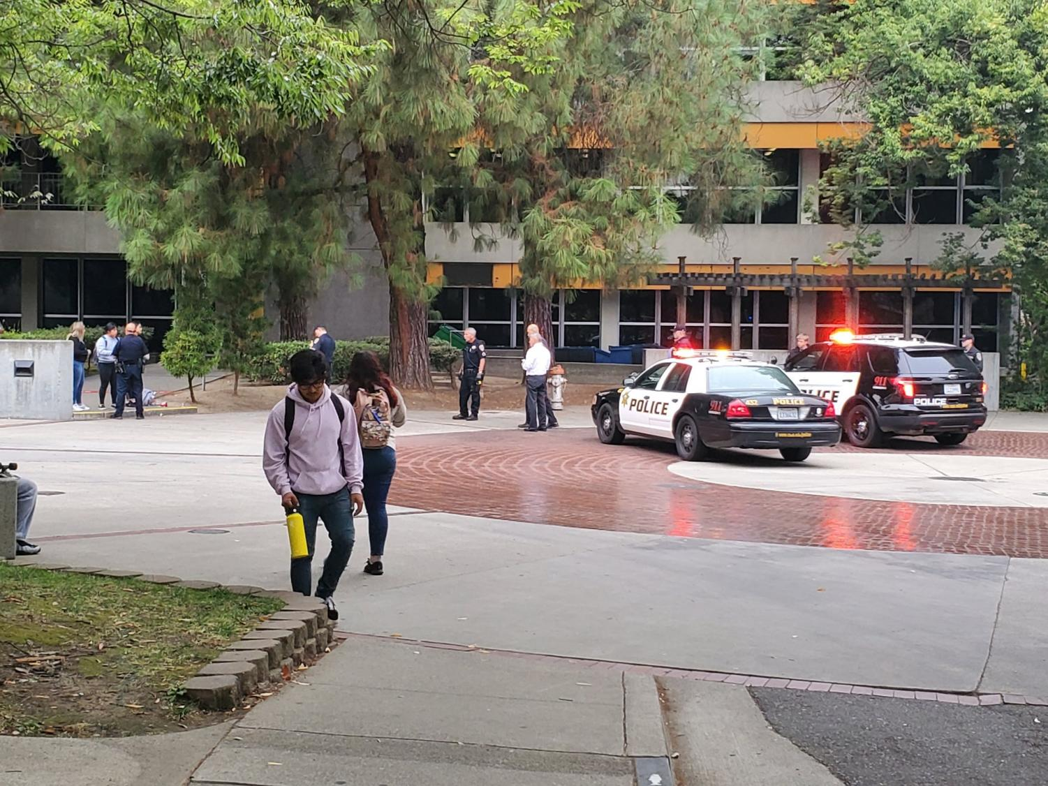 Police responding to a man having a seizure outside of Sequoia hall on Wednesday. The man was taken to the hospital and later died, according to Jeannie Wong, vice president of University Communications.