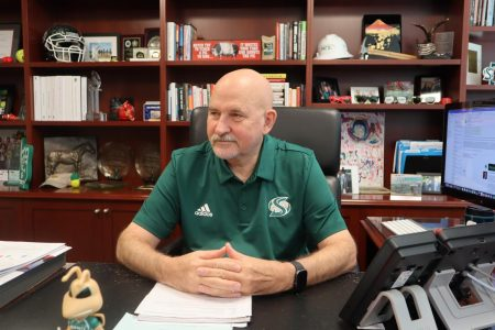 Robert Nelsen, president of Sacramento State, sits in his office in Sacramento Hall on Sept. 6. Nelsen regularly attends the university
