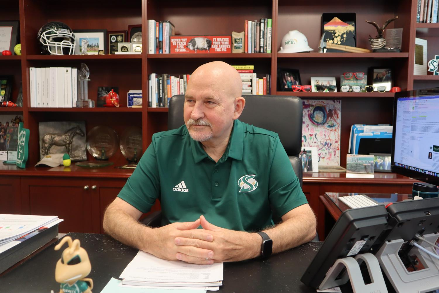 Robert Nelsen, president of Sacramento State, sits in his office in Sacramento Hall on Sept. 6. Nelsen regularly attends the university's athletic events.