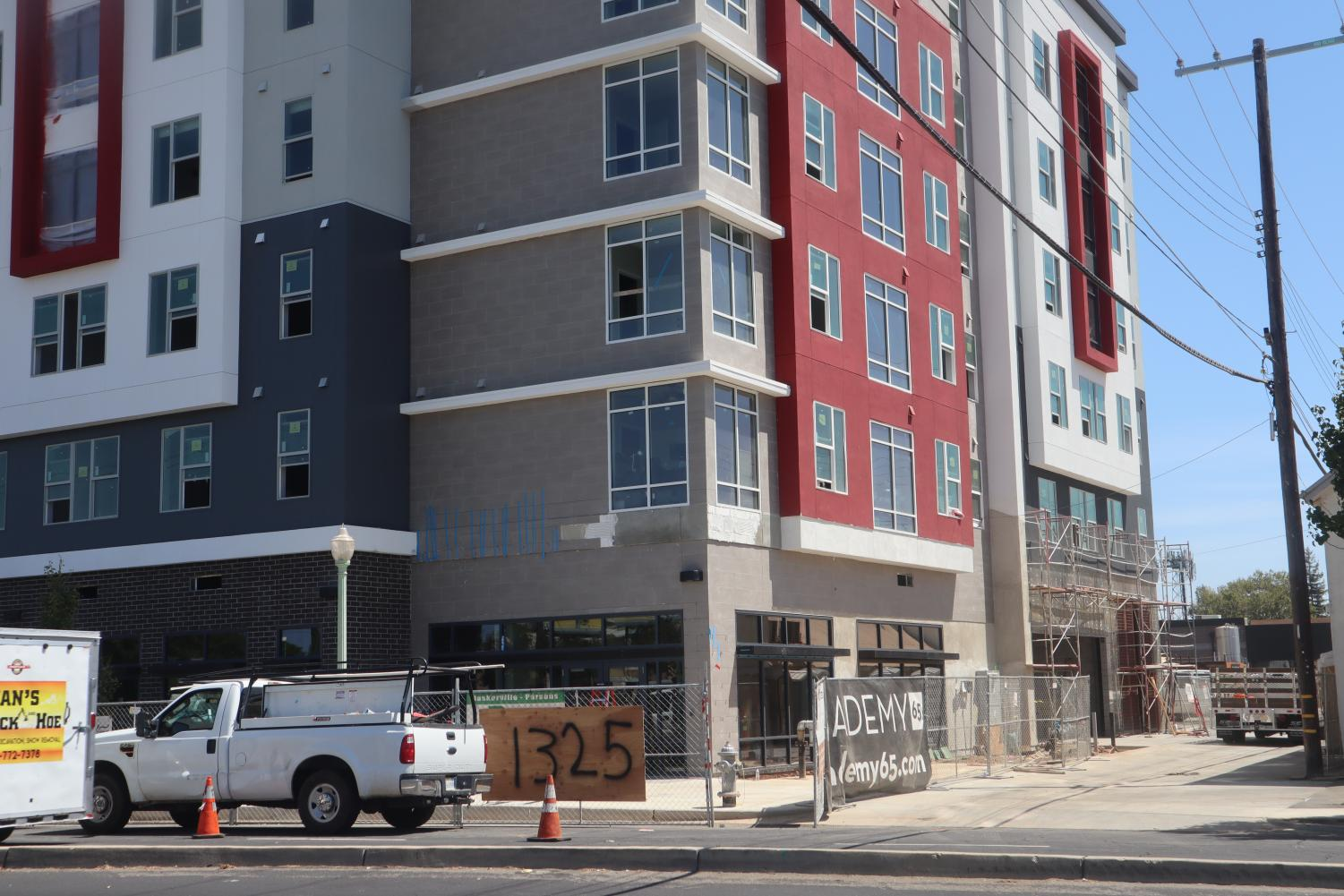 Construction at Academy65. The apartment complex's delay is irresponsible.