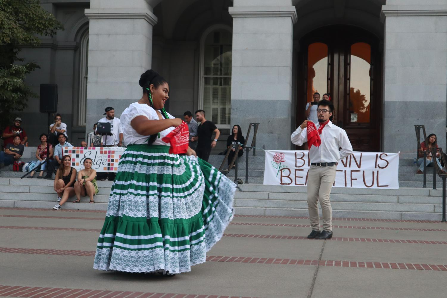 President of Sac State's Baile Folklorico Roxana Javier dances with member Mario Mendez Lopez at the California State Capitol on Tuesday, Sept. 3. Sac State's Brown Issues organization gathered members of the community to honor the lives lost in the Aug. 3 El Paso shooting.