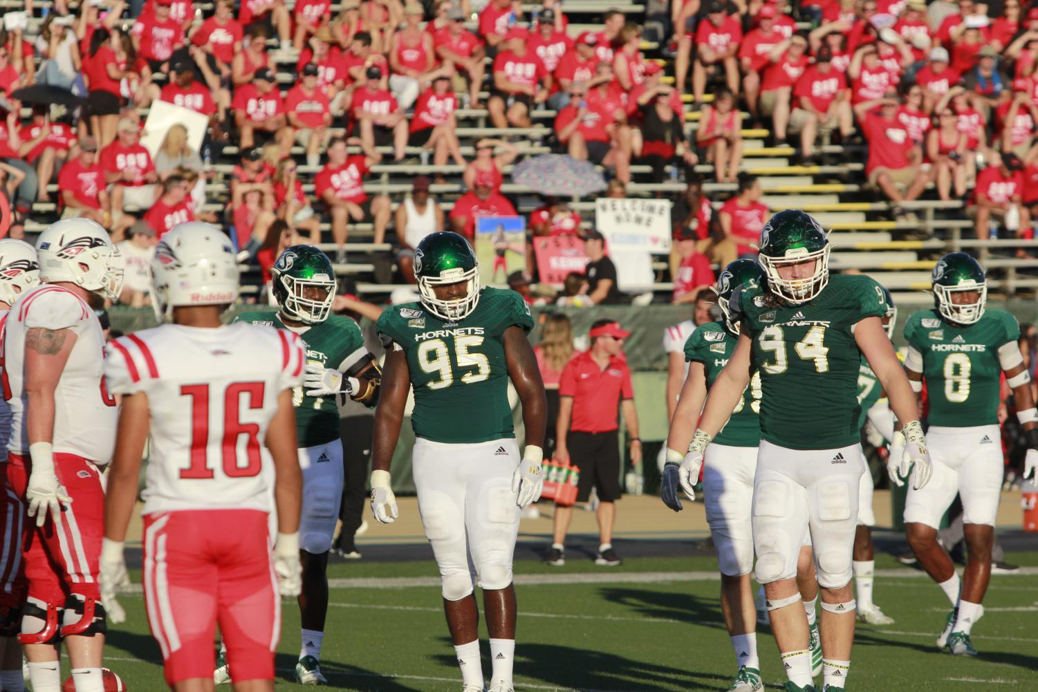 Sac+State+defensive+linemen+senior+Dariyn+Choates+%28%2395%29%2C+junior+Wyatt+Hjelm+%28%2394%29+and+senior+defensive+back+Caelan+Barnes+%28%238%29+along+with+other+members+of+the+defense+look+to+the+sideline+for+a+play+call+against+Southern+Oregon+on+Saturday%2C+August+31%2C+at+Hornet+Stadium.+The+three+players+combined+for+five+total+tackles.