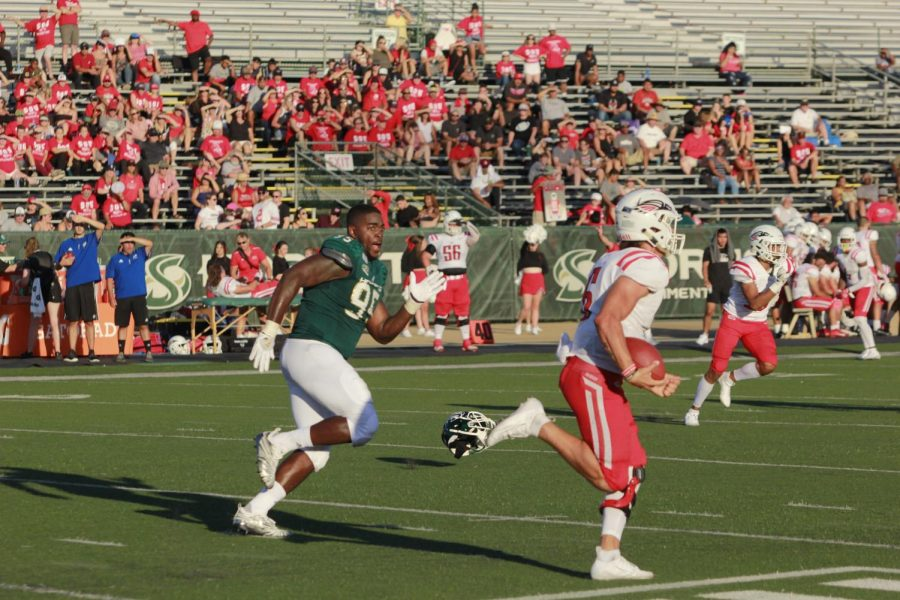 Sac+State+senior+defensive+lineman+Dariyn+Choates+sprints+after+the+Raiders+quarterback+after+his+helmet+falls+off+against+Southern+Oregon+on+Saturday%2C+August+31+at+Hornet+Stadium.+The+Hornets+went+on+to+win+the+game+77-19+and+broke+several+records.