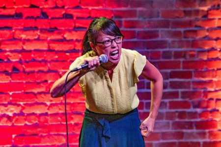 Pauline Yasuda, San Francisco Comedy Competition finalist, performs during the semifinals at the El Rey in Chico on Sept. 17, 2019. Sac State will host a round of the competition's finals in the University Union Ballroom Thursday.