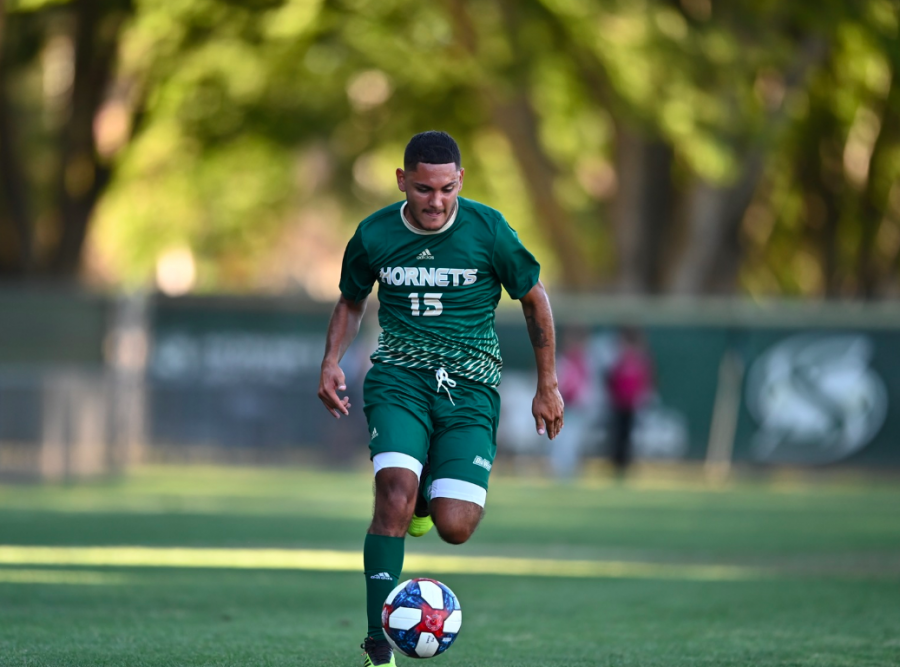 Sac+State+sophomore+forward+Arath+Chavez+dribbles+the+ball+up+field+against+Army+on+Friday%2C+Sept.+6+at+Hornet+field.+Chavez+scored+one+goal+to+help+lead+his+team+to+the+2-0+win.