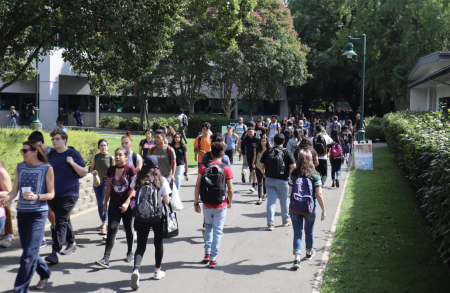 Sac State students crowd the walkway near Placer Hall during the fall 2019 semester. The California State University system has suspended all international and non-essential domestic travel for all campuses and auxiliary organizations until May 31.