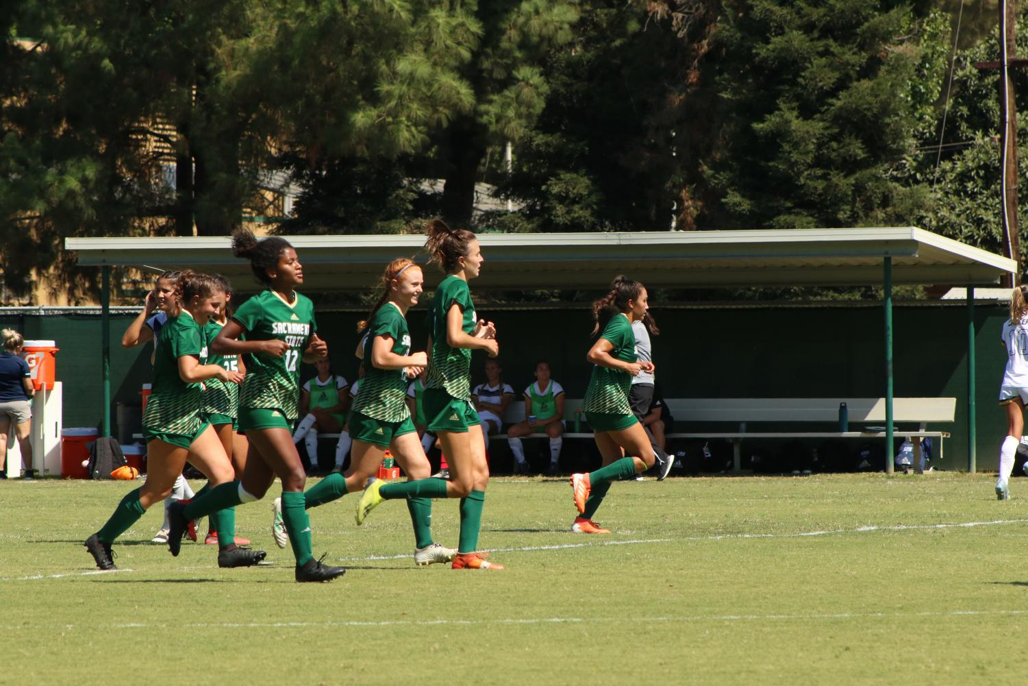 Members+of+the+Sac+State+women%27s+soccer+team+jog+up+the+field+against+Cal+Baptist+on+Sunday%2C+Sept.+8+at+Hornet+Field.+The+Hornets+and+Lancers+played+a+2-2+draw.