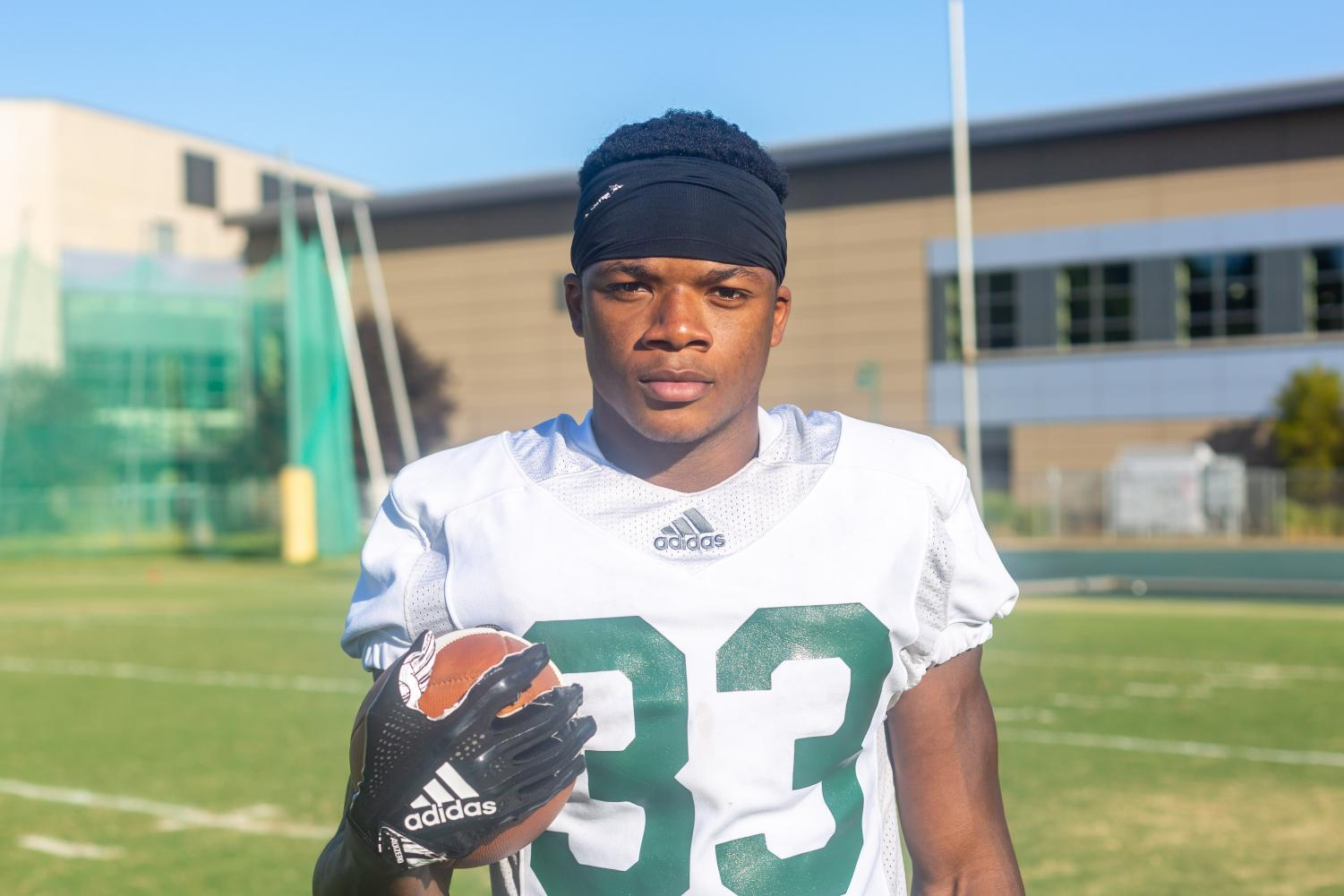 Elijah Dotson, Sac State junior running back, poses for a photo after practice on Wednesday, Sept. 4, at the practice field. Dotson was named to the All-Big Sky first team in 2018, becoming the first Hornet RB to do so since 2000.