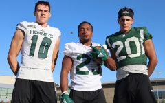 From left, Sac State football players, freshman WR Parker Clayton, senior RB Ja'Narrick James and sophomore DB Abel Ordaz pose for a photo after practice on Thursday, Sept. 19. All three players were walk-ons and recently earned scholarships.