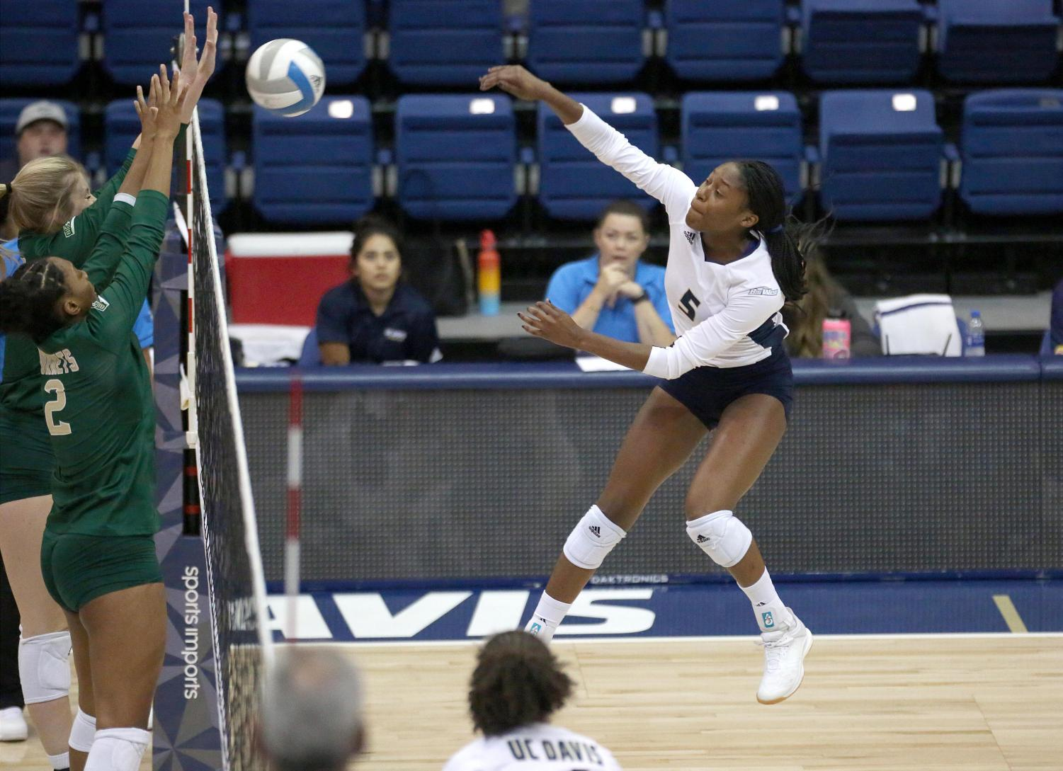Sac State junior middle blocker Cianna Andrews attempts to block UC Davis sophomore outside hitter Mahalia White on Tuesday, Sept. 3 at the Pavillion. The Hornets began their 12-game road trip with a 3-1 loss to the Aggies.