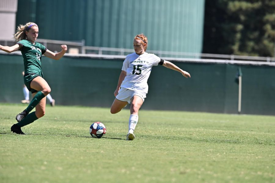 Sac State senior midfielder Mikayla Reed prepares to kick the ball against Cal Poly on Sunday, Aug. 25 at Hornet Field. The Hornets defeated the Mustangs 3-1.