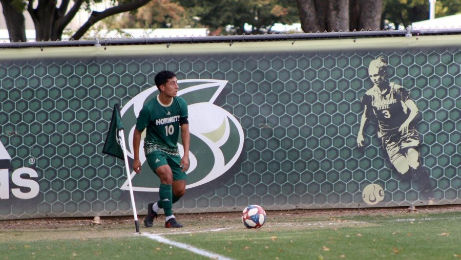 Sac State sophomore midfielder Oscar Govea takes a corner kick against Cal State Fullerton Saturday, Oct. 19 at Hornet Field. The Hornets lost to the Titans in overtime 2-1.