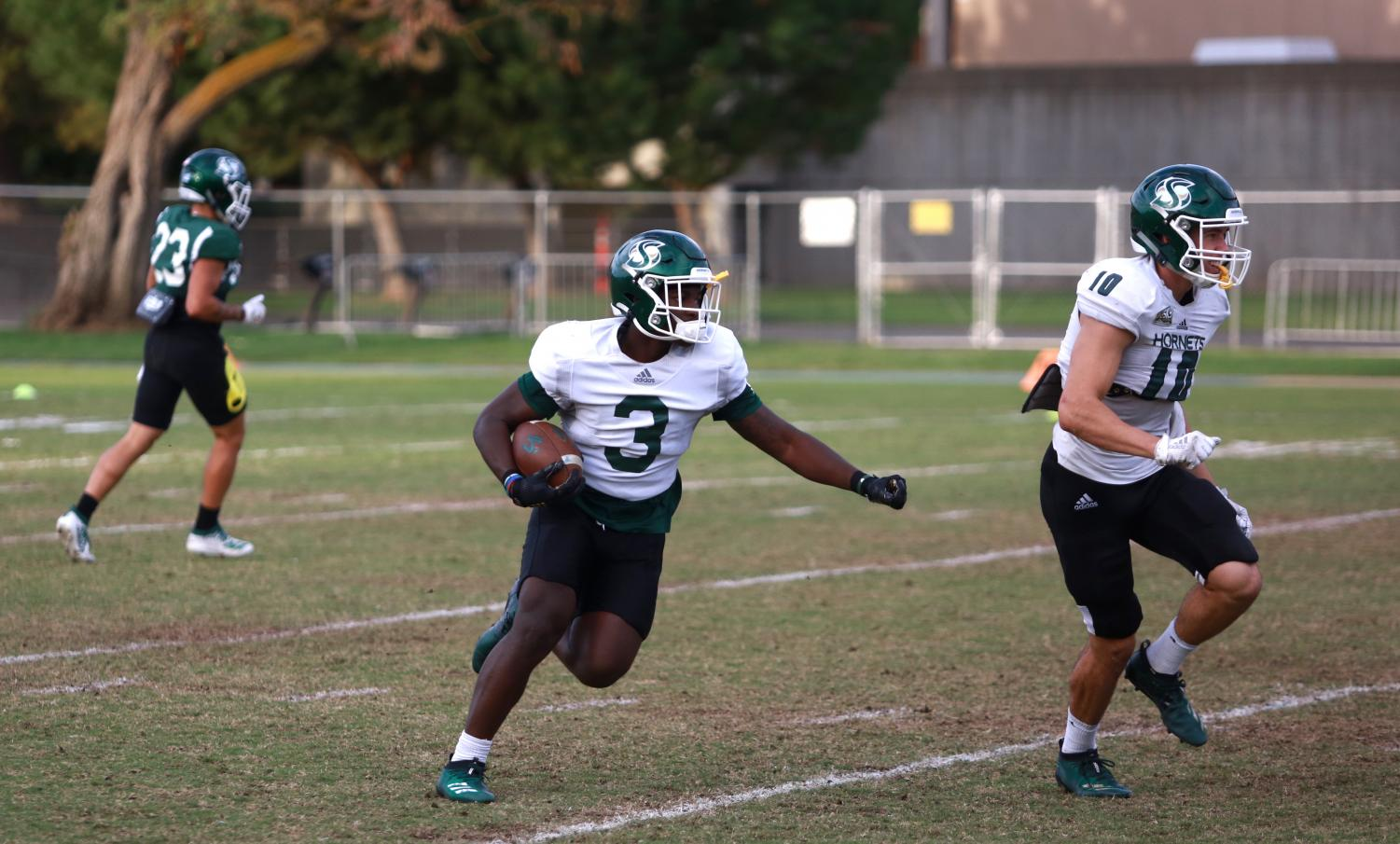 Sac State freshman running back Marcus Fulcher returns a kickoff with freshman wide receiver Parker Clayton as his lead blocker during practice Tuesday, Oct. 8 at the practice field. The Hornets play at No. 6 Montana State Saturday.