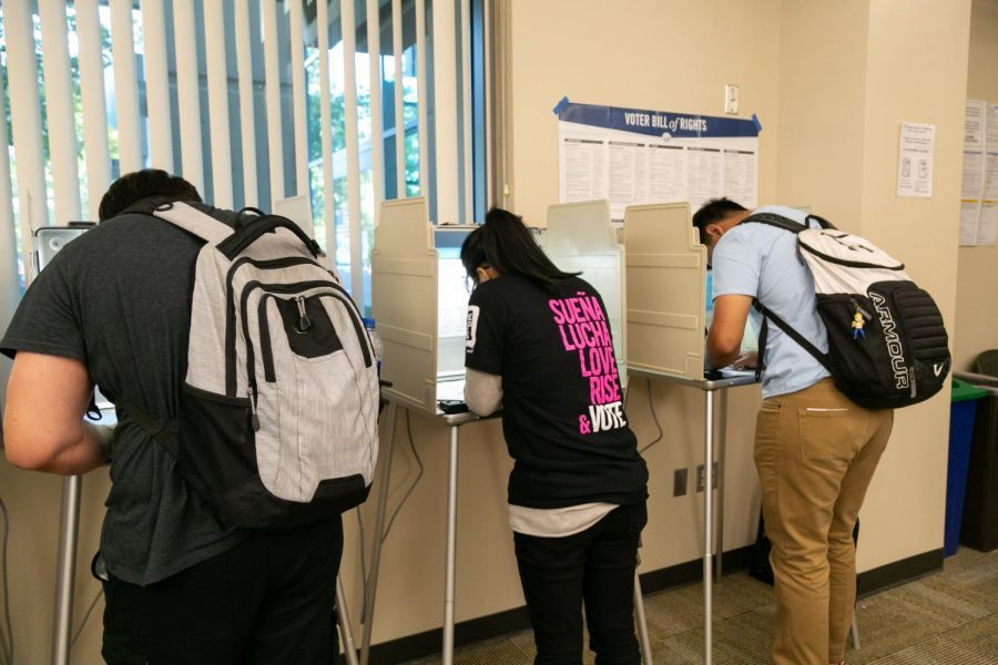 Voters cast their ballots at the vote center in Modoc Hall Tuesday, Nov. 6, 2018. Gov. Gavin Newsom recently signed Assembly Bill 59 which prioritizes placing vote centers on college campuses.